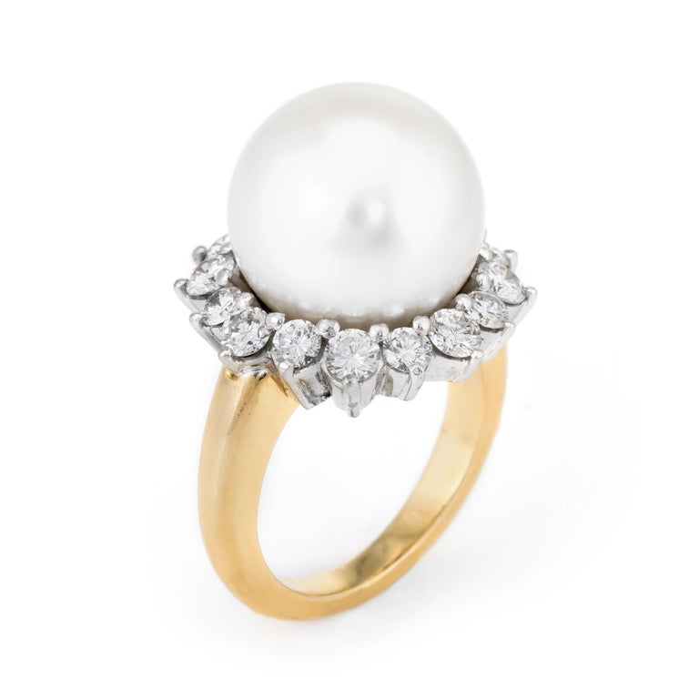 Finely detailed vintage Hammerman Brothers South Sea Pearl & diamond ring, crafted in 18 karat yellow gold and 900 platinum.   Centrally mounted cultured Tahitian South Sea Pearl measures 13.40mm, accented with 16 round brilliant cut diamonds with