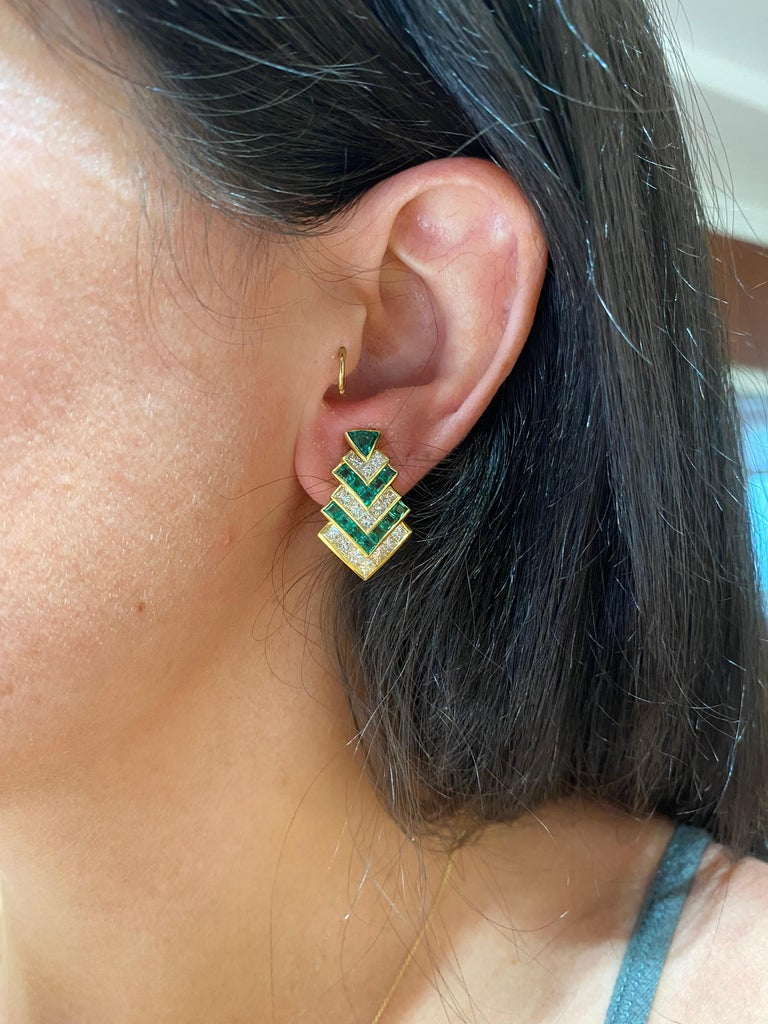 Chevron designed diamonds and emeralds for a refined but edgy look. Hammerman Brothers 18 karat yellow gold emerald and diamond earrings with square-cut emeralds and diamonds with a trilliant cut emerald top. 30 princess cut diamonds, totaling 3.57