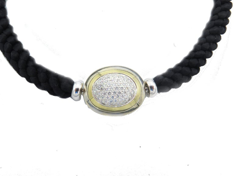 Crafted with the highest quality materials, this Hammerman Fine Diamond Choker is an elegant piece of neck jewelry. This luxurious cord necklace measures 15.75 inches in length and the width/thickness is 0.25 inches. The 18k gold oval is 0.75in