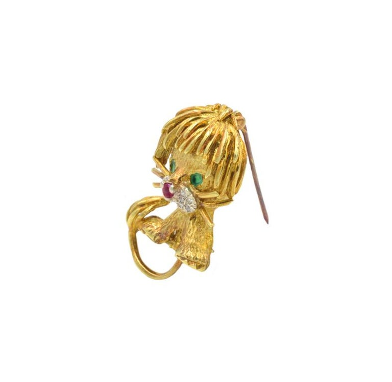 Whimsical Hammerman Lion in 18k yellow gold with 10 single cut diamonds, emerald eyes and ruby nose. 1.25 inches tall. Circa 1960s