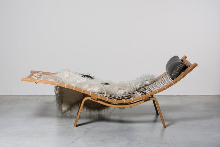 Hammock chaise loungeby Hans Wegner. Denmark, 1967. Manufactured by GETAMA, PP Mobler. Braided rope, wood, metal, leather, fur. 183 x 73 x H 78 cm H seat 28 cm. 72 x 28.7 x H 30.7 in H seat 11 in.