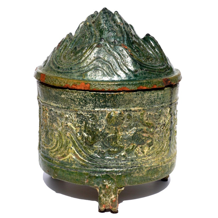 Han earthenware celadon glazed hill jar  The hill jar represents the five scared mountains which is the path between the earth and paradise. The scared mountains are filled with animals that live there.  This jar might also represent either