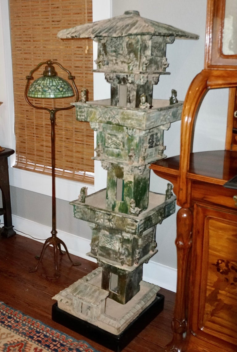 Monumental Pottery Watch Tower in Green Glaze; Han Dynasty (2016 BC -AD 220)   Earthenware three-storied pavilion from the Eastern Han Dynasty. Each of the three sections have two levels making it a six level tower. All levels have archers with