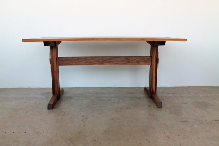 The Hana trestle dining table is inspired by time spent on the east coast of Maui; an enclave of 'back to the land' types who settled there in the 1960s. The homes are all built by hand with local materials and Primitive, yet time honored