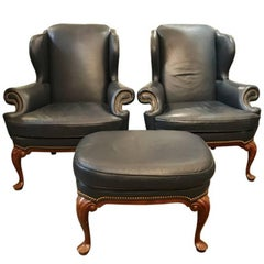 Hancock and Moore Two Wing Chairs and Ottoman