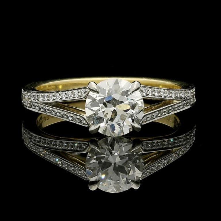 1.05ct J VS1 old European brilliant cut diamond with GIA certificate  0.30cts round brilliant cut diamonds 18ct yellow gold and platinum with maker's mark and London assay marks UK finger size L, can be adjusted to your own finger size 4.4 grams  An