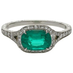Hancocks 1.13 Carat Colombian Emerald and Platinum Diamond Cluster Ring