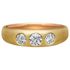 Hancocks 18 Carat Gold and Round Brilliant Diamond Gypsy-Set Three Stone Ring