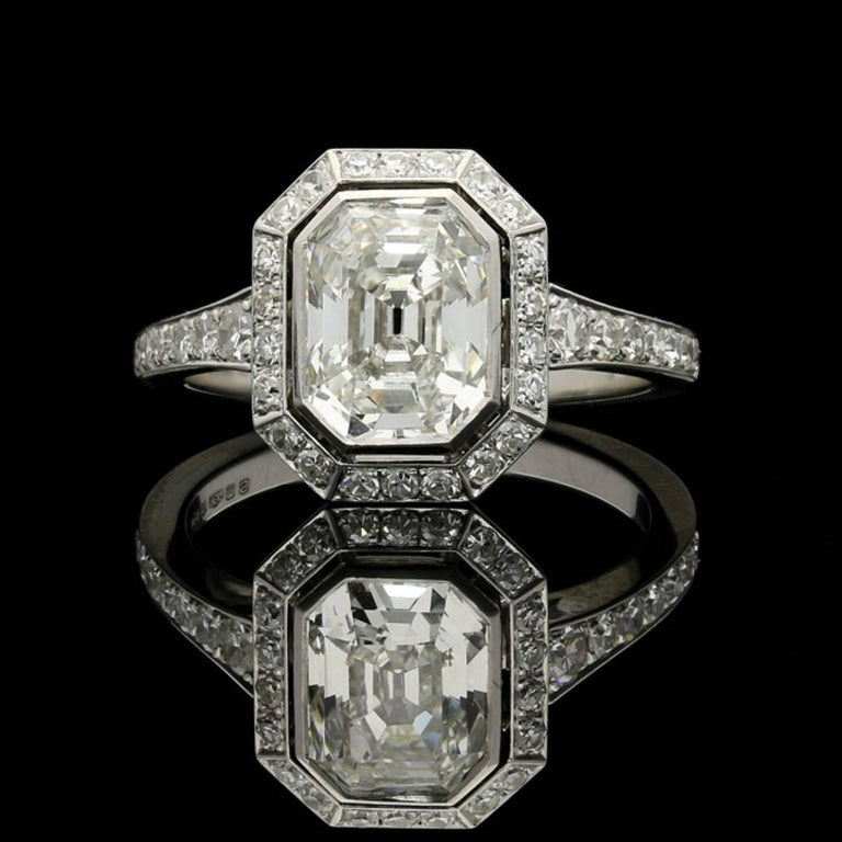 1.82ct  vintage cut emerald cut diamond with GIA certificate  0.42cts total of single cut diamonds. Platinum with maker's mark and London assay marks UK finger size L, US size 6, can be adjusted to your own finger size 5.9 grams  A stunning