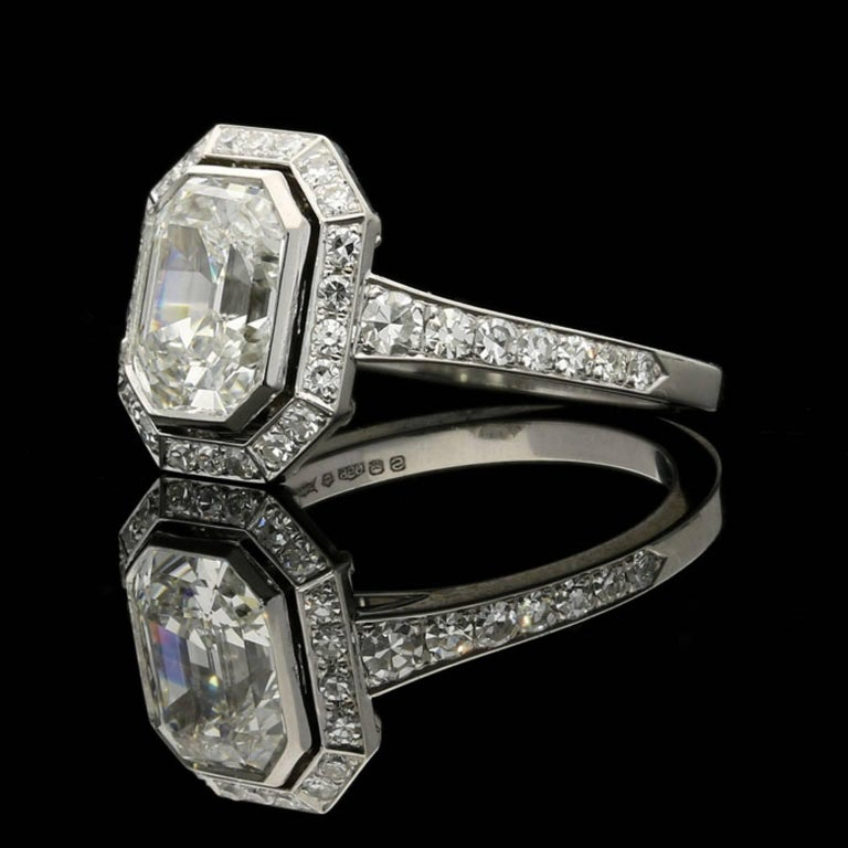Contemporary Hancocks 1.82 Carat Emerald-Cut Diamond Ring with a Diamond-Set Halo For Sale