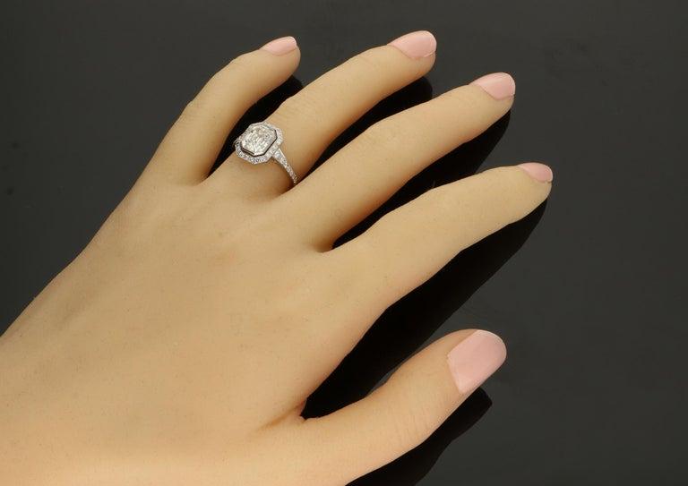 Contemporary Hancocks 1.82 Carat Emerald-Cut Diamond Ring with a Diamond-Set Halo For Sale
