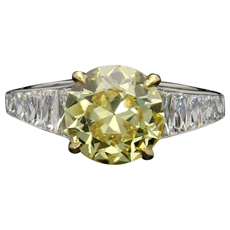 2.41 Carat Fancy Intense Yellow Diamond Ring & French-Cut Shoulders by Hancocks
