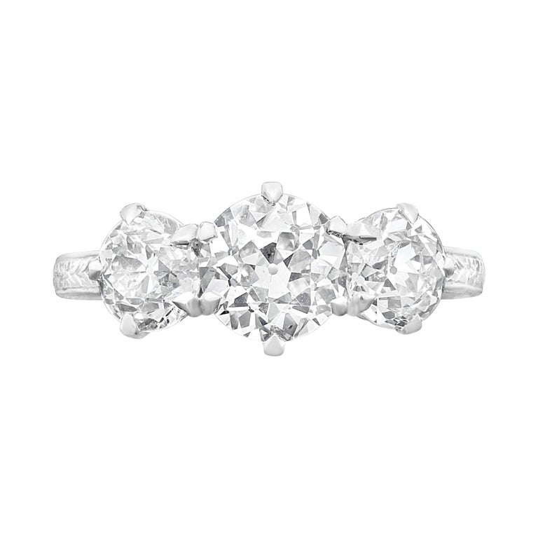 Hancocks 2.62 Carat Diamond Three-Stone Ring in Finely Hand Engraved Platinum For Sale