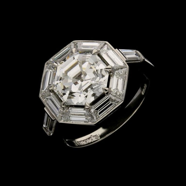 Women's or Men's Hancocks 3.02Ct Octagonal Step-Cut Diamond Ring with Geometric Diamond Surround For Sale
