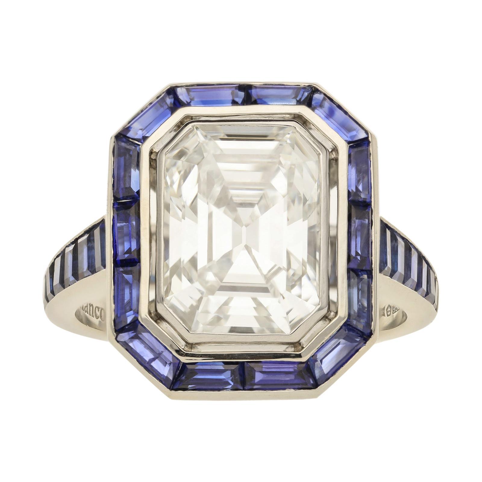 3.10 Carat G SI1 Emerald Cut Diamond & Calibre-Cut Sapphir Ring by Hancocks