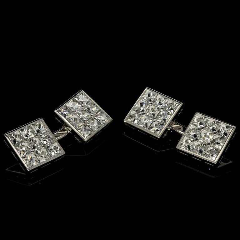 36 x French-cut diamonds weighing a combined total of 3.10cts and of G VS quality Platinum with maker's mark and signature and London assay marks Each face 10mm square 12 grams  A wonderful pair of elegant diamond cufflinks by Hancocks, each doubled