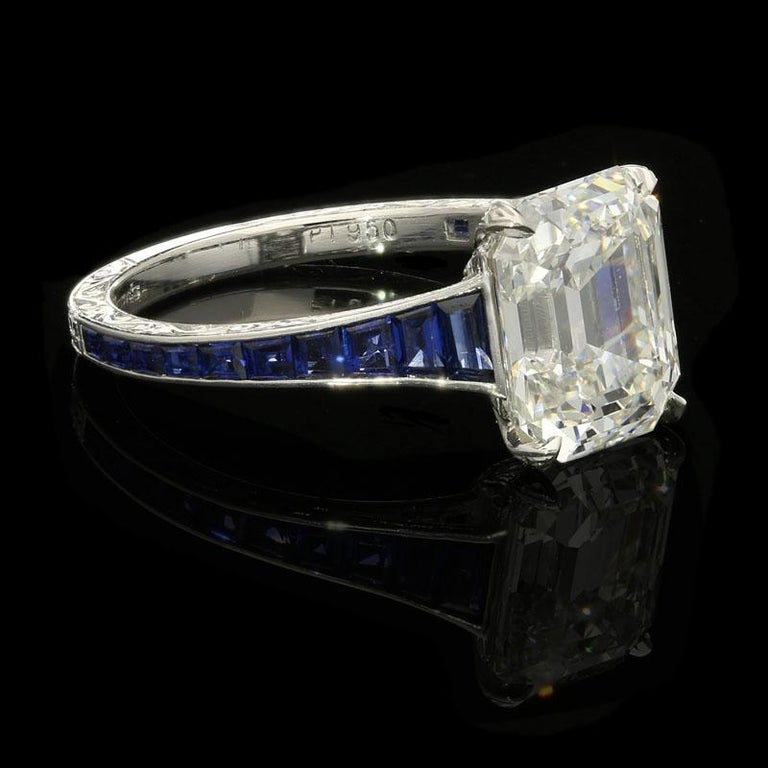 3.20ct H VVS1 emerald cut diamond with GIA certificate  0.70cts total of calibre cut sapphires Platinum with maker's marks UK finger size L, can be adjusted to your own finger size 3.8 grams  A beautiful emerald-cut diamond ring by Hancocks, centred