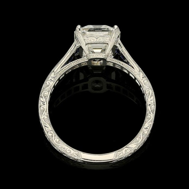 Emerald Cut Hancocks 3.20 Carat Emerald-Cut Diamond Ring with Calibre-Cut Sapphire Band For Sale