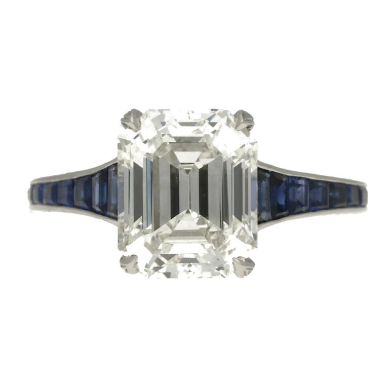 Hancocks 3.20 Carat Emerald-Cut Diamond Ring with Calibre-Cut Sapphire Band In Good Condition For Sale In London, GB