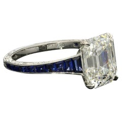 Hancocks 3.20 Carat Emerald-Cut Diamond Ring with Calibre-Cut Sapphire Band