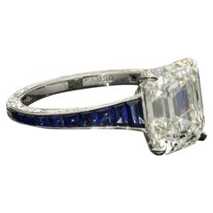 Hancocks 3.20 Carat Emerald-Cut Diamond Ring with Calibre-Cut Sapphire Band