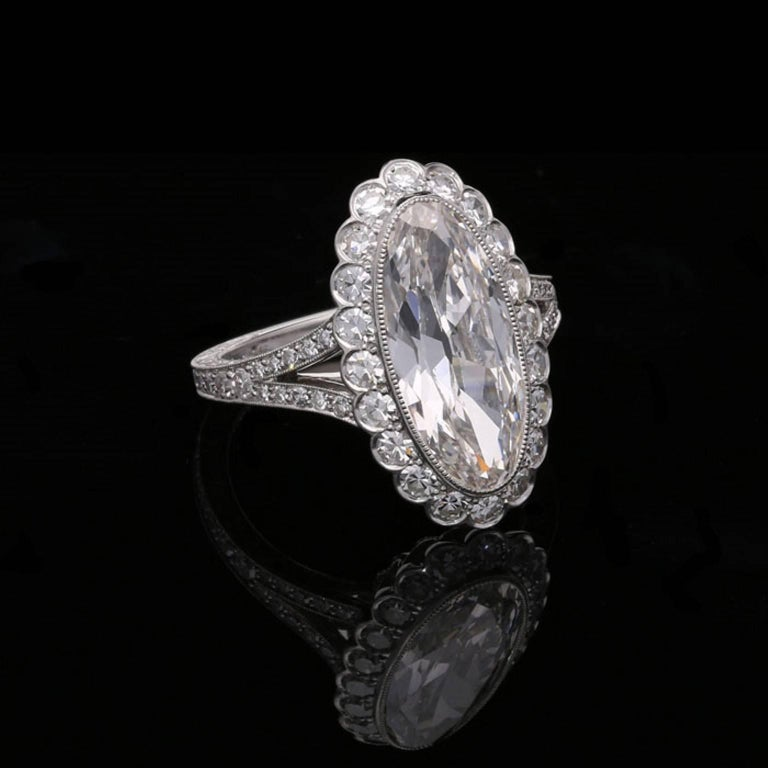 Contemporary Hancocks 3.35 Carat Moval Diamond Ring with Scalloped Halo and Split Shoulders For Sale