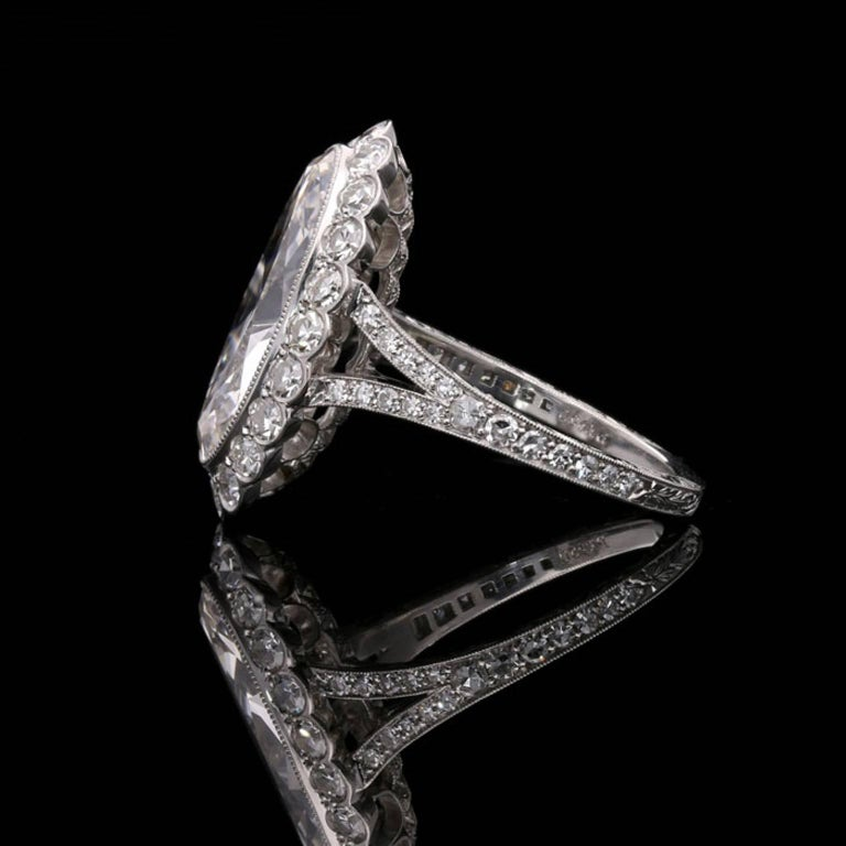Oval Cut Hancocks 3.35 Carat Moval Diamond Ring with Scalloped Halo and Split Shoulders For Sale