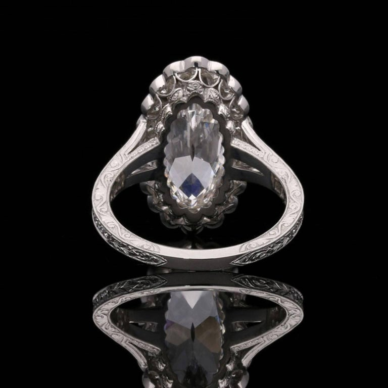Hancocks 3.35 Carat Moval Diamond Ring with Scalloped Halo and Split Shoulders In Good Condition For Sale In London, GB
