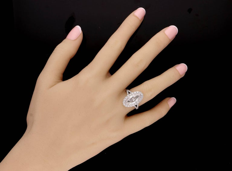Women's Hancocks 3.35 Carat Moval Diamond Ring with Scalloped Halo and Split Shoulders For Sale