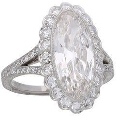 Hancocks 3.35 Carat Moval Diamond Ring with Scalloped Halo and Split Shoulders