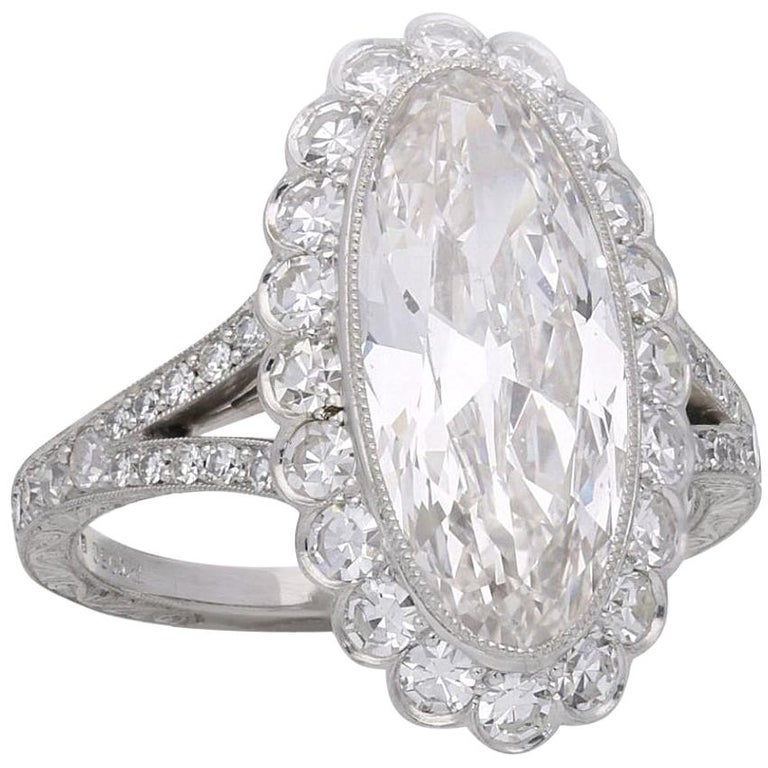 Hancocks 3.35 Carat Moval Diamond Ring with Scalloped Halo and Split Shoulders For Sale