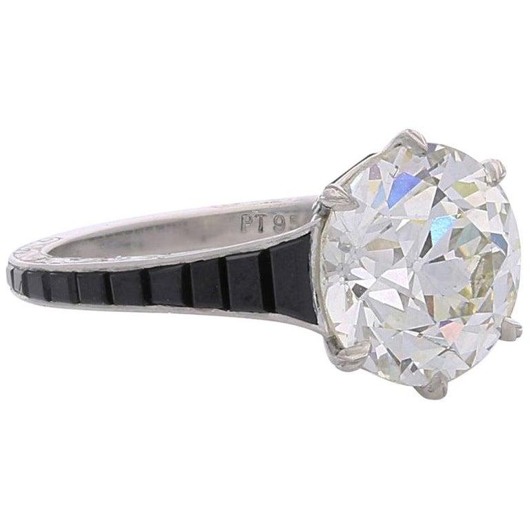 4.14-carat old European-cut diamond ring with calibré onyx shoulders