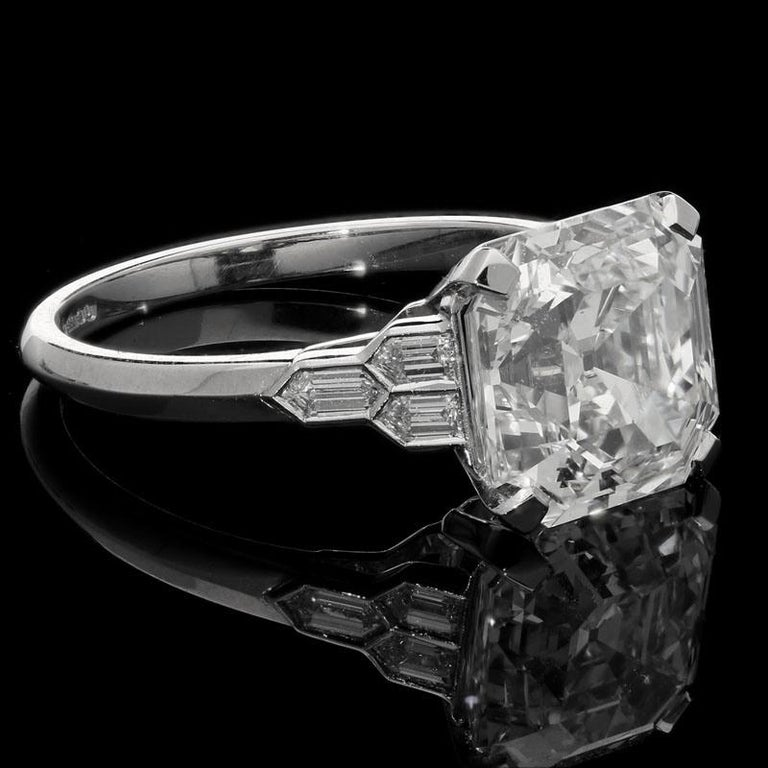 4.58 Carats G VS2 Asscher cut diamond with GIA certificate  6 x matching grade bullet cut diamonds with a combined weight of 0.22 carats Platinum with maker's mark and London assay marks UK finger size M, can be adjusted to your own finger size 4.6