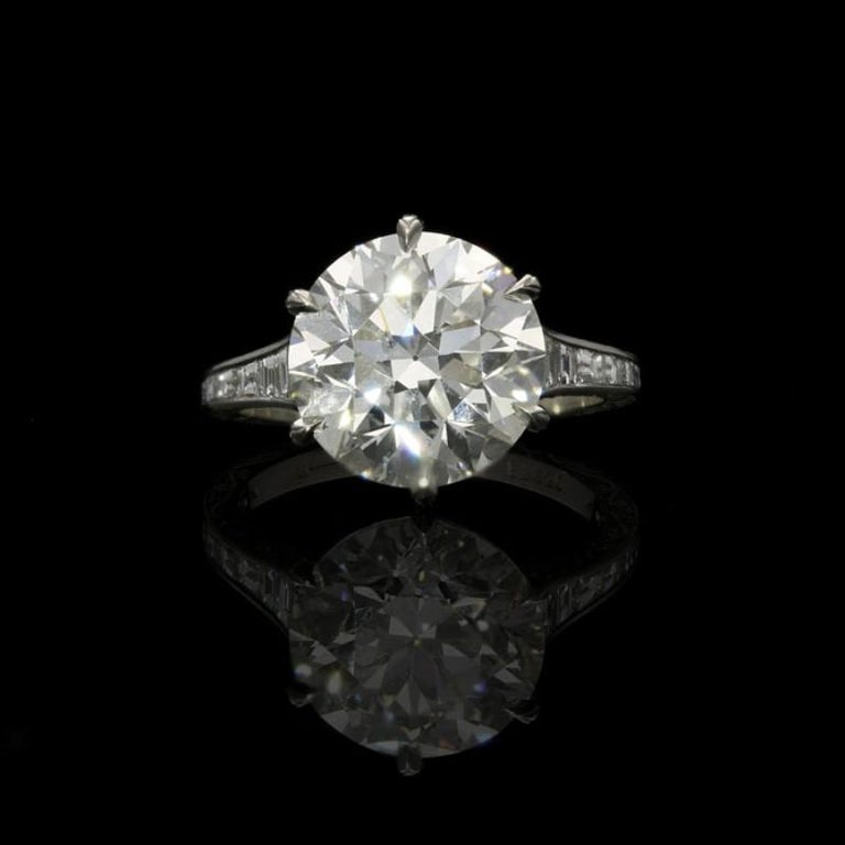 5.07ct G SI1 old European brilliant cut diamond with GIA certificate Calibre-cut diamonds weighing a combined total of 0.87cts Platinum with maker's signature UK finger size K, US size 5.5 resizable 5.2 grams  A stunning diamond ring by Hancocks set