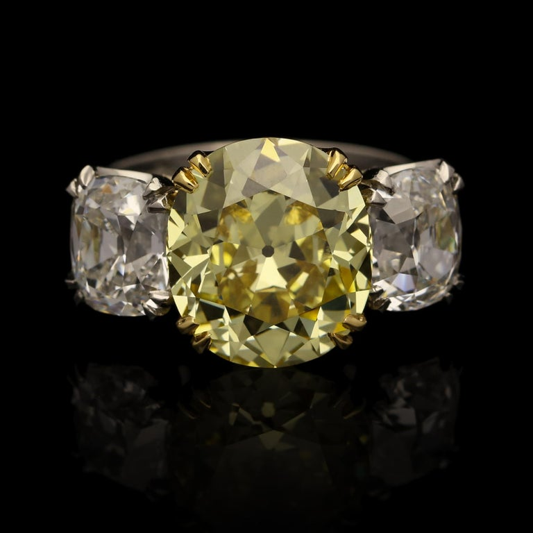 5.13ct FIY VVS1 cushion brilliant diamond with GIA certificate 1.50ct F VS2 Old Mine brilliant cut diamond with GIA certificate  1.50ct F VS1 Old Mine brilliant cut diamond with GIA certificate  18ct yellow gold and platinum with maker's mark and