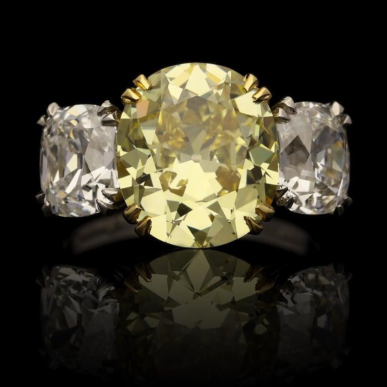 Contemporary Hancocks 5.13 Carat Fancy Yellow Cushion Three-Stone Ring Platinum Diamond Ring For Sale