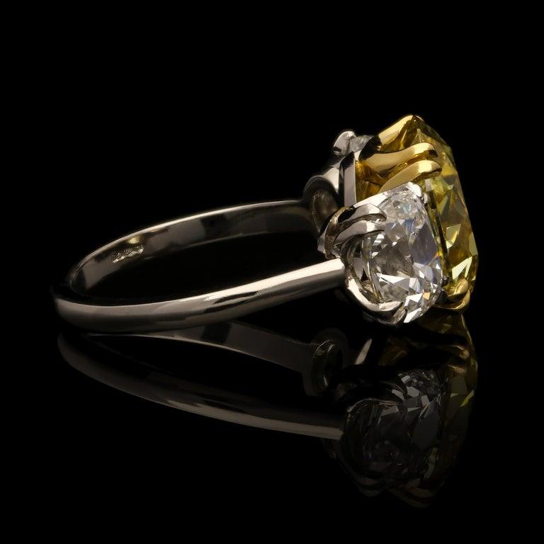 Hancocks 5.13 Carat Fancy Yellow Cushion Three-Stone Ring Platinum Diamond Ring In Good Condition For Sale In London, GB