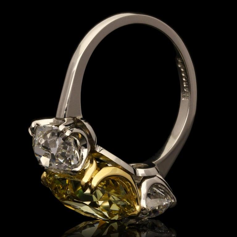 Women's Hancocks 5.13 Carat Fancy Yellow Cushion Three-Stone Ring Platinum Diamond Ring For Sale