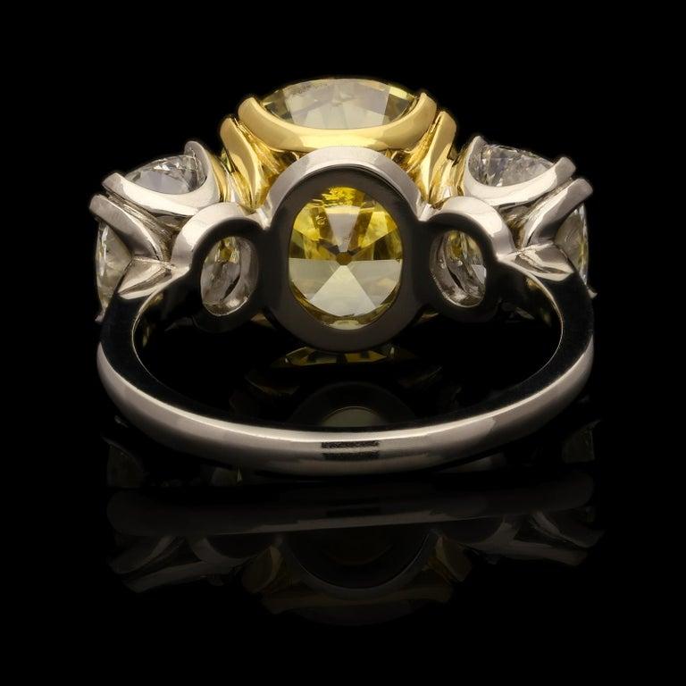Hancocks 5.13 Carat Fancy Yellow Cushion Three-Stone Ring Platinum Diamond Ring For Sale 1