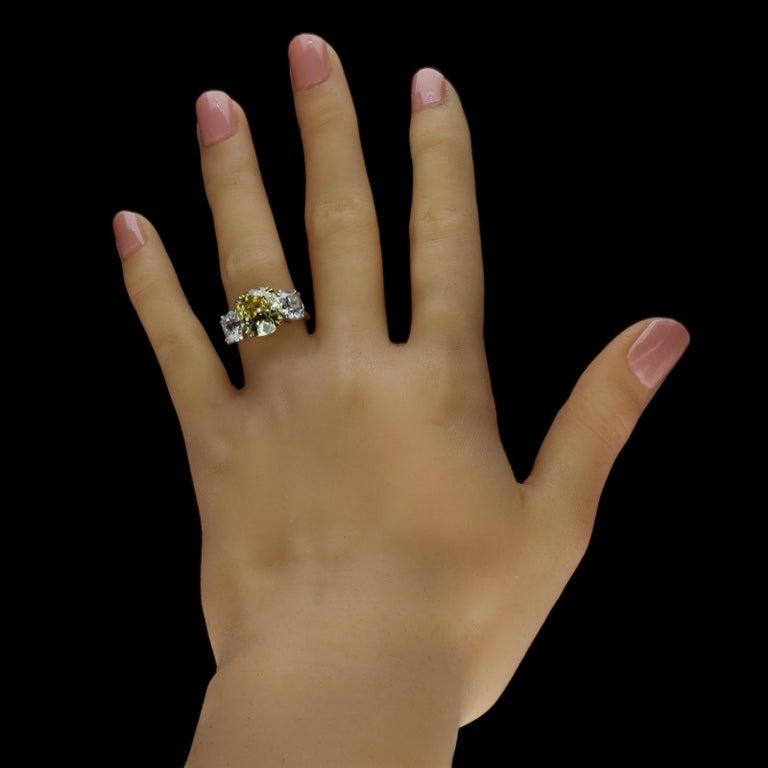 Hancocks 5.13 Carat Fancy Yellow Cushion Three-Stone Ring Platinum Diamond Ring For Sale 2