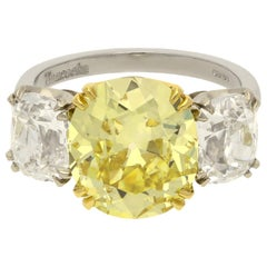 Hancocks 5.13 Carat Fancy Yellow Cushion Three-Stone Ring Platinum Diamond Ring