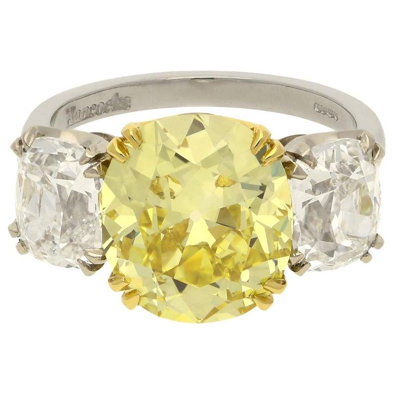 Hancocks 5.13 Carat Fancy Yellow Cushion Three-Stone Ring Platinum Diamond Ring For Sale