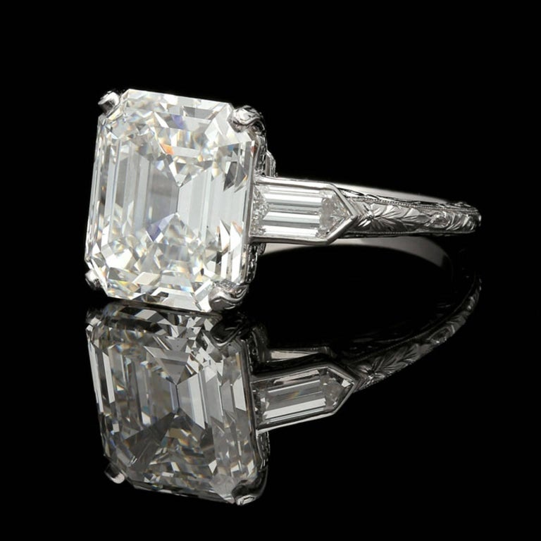 6.24Carat I VS2 Emerald cut diamond with GIA certificate  Platinum UK finger size M 1/2, US size 6.75, can be adjusted to your own finger size 5.9 grams  An elegant emerald cut diamond ring by Hancocks, the ring set with a beautiful emerald cut