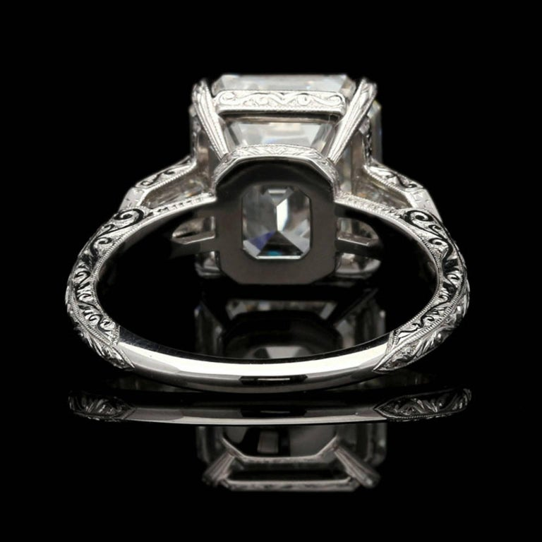 Women's Hancocks 6.24 Carat Emerald Cut Diamond Ring with Bullet Diamond Shoulders For Sale