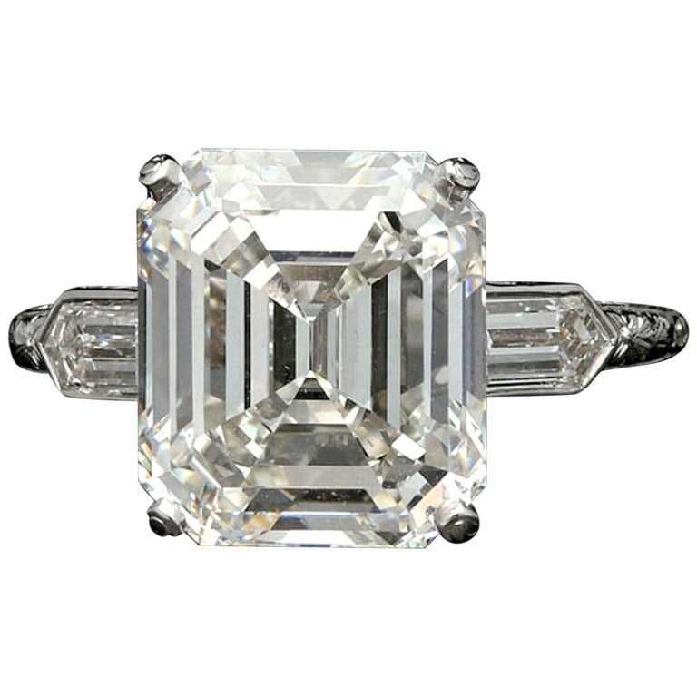 Hancocks 6.24 Carat Emerald Cut Diamond Ring with Bullet Diamond Shoulders For Sale