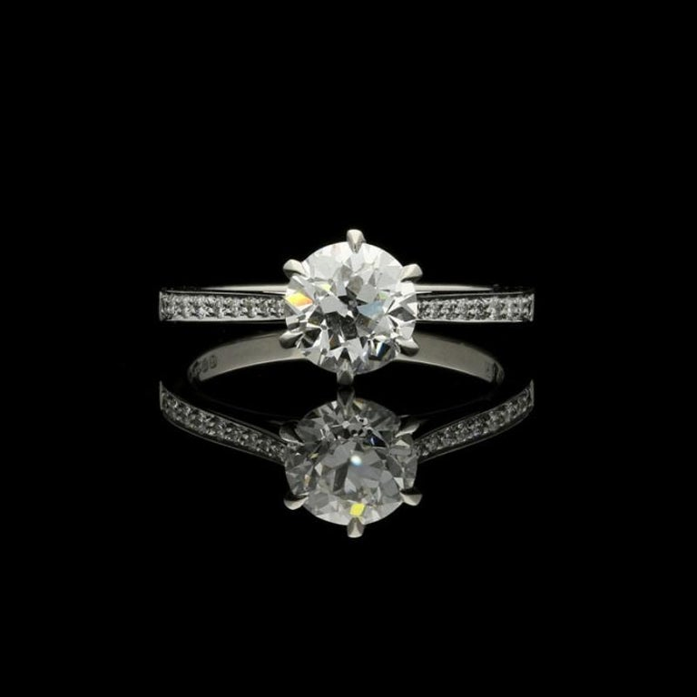 Old European brilliant-cut diamond 1.33ct F VVS2 accompanied by a GIA certificate 18 round brilliant cut diamonds weighing 0.17cts total UK finger size L, US size 6,can be adjusted to your own finger size 3.5 grams  A classic diamond solitaire ring