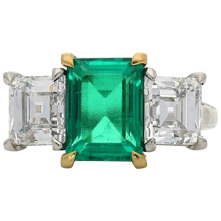 2.68 carat Colombian Emerald and Carre Cut Diamond Three-Stone Ring by Hancocks