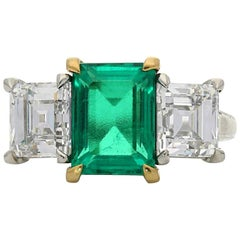 2.68 carat Colombian Emerald and Carre Cut Diamond Three-Stone Ring by Hancocks