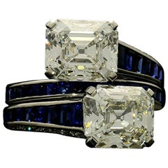 Hancocks Emerald-Cut Diamond and Calibre Sapphire Cross over Platinum Ring