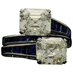 Hancocks Emerald-Cut Diamond and Calibre Sapphire Cross over Platinum Ring